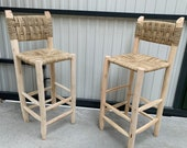 Wooden bar high chair and rope