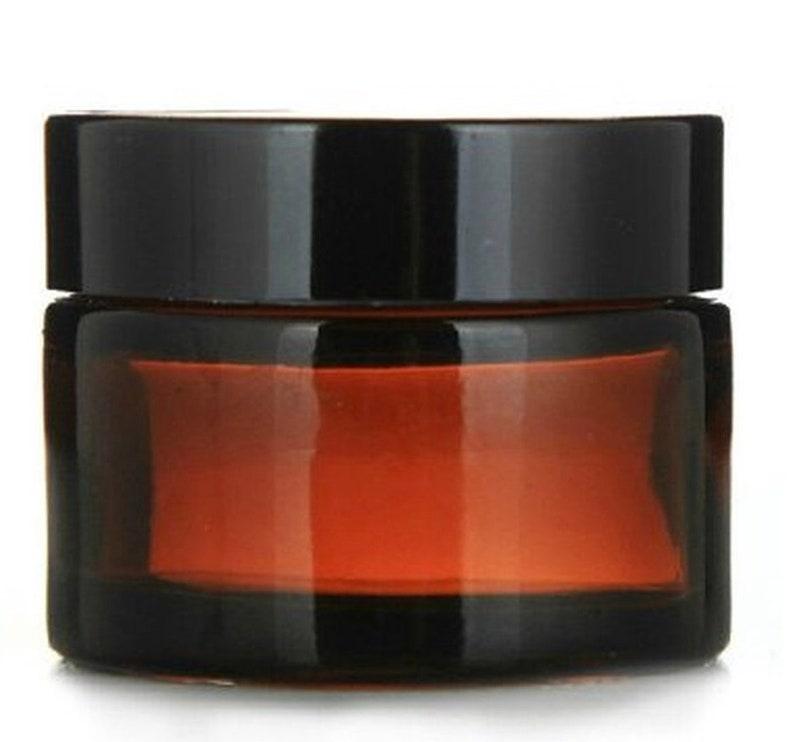 40 pack of Glass 1 oz Amber Cream Jar w/ Black Lids image 0