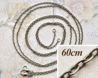 2 bronze-colored 60cm necklaces with snap hooks