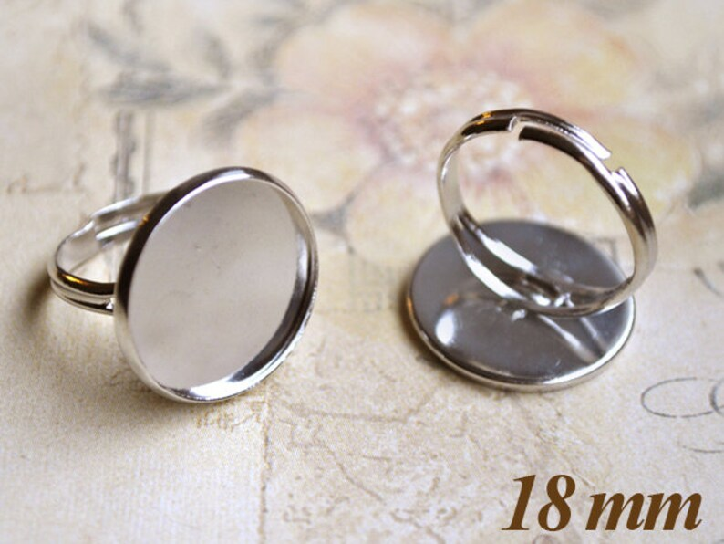 2 silver-colored 18mm ring blanks