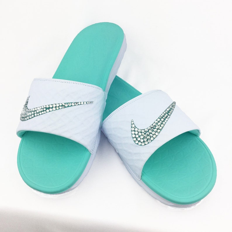 92c937dfa Nike Benassi Solarsoft Slide White Teal Women Sandals with