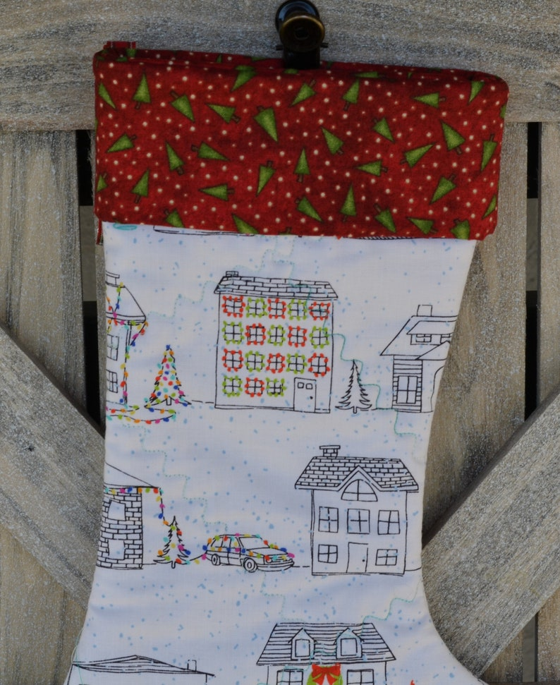 Snowy Houses with decorations Stocking