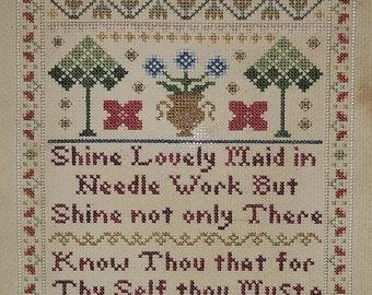 Shine Lovely Maid in Needle Work Sampler