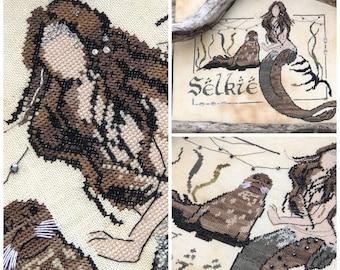 Selkie by The Primitive Hare cross stitch chart design primitive mermaid walrus sea lion fantasy magic mythical seashell ocean sea tiara