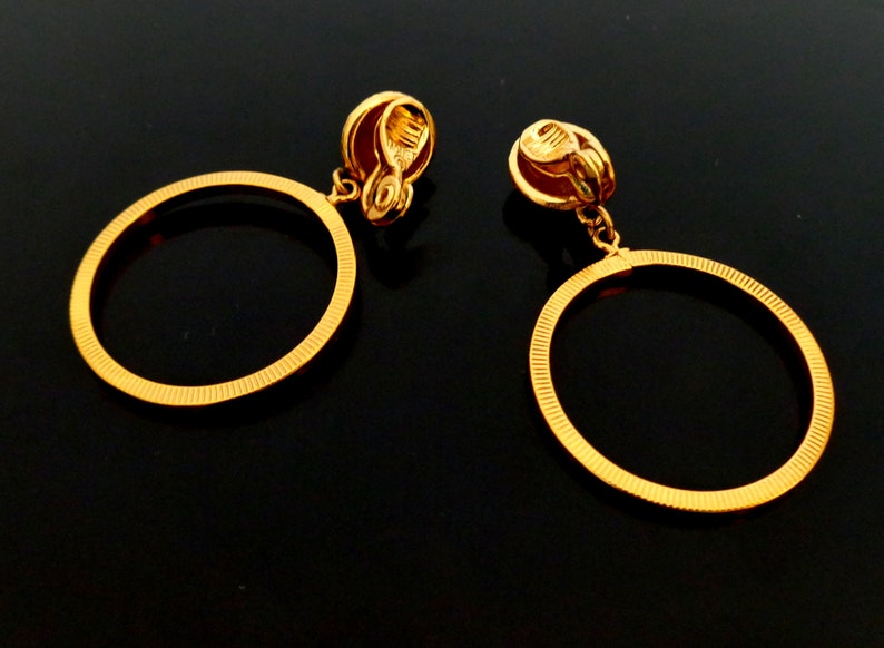 Beautiful vintage 1980s Goldplated well made solid and good quality Designer MONET signed Clip Earrings in excellent condition 5 x 3 cm