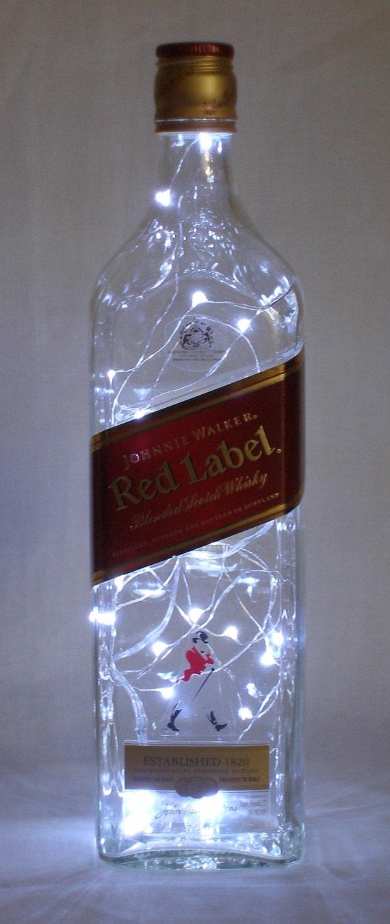 Johnnie walker red label bottle accent light fire fly