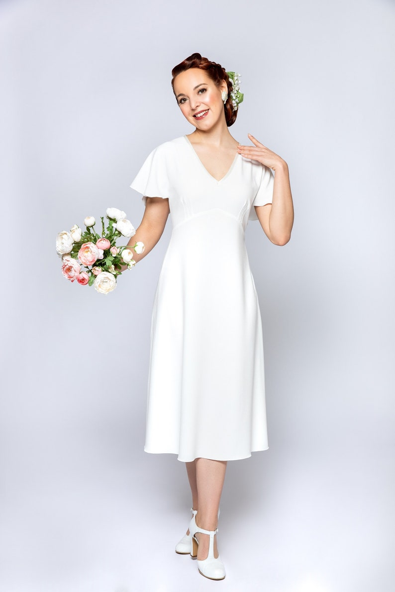 1940s Style Wedding Dresses | Classic Wedding Dresses Dress Harlow White A-line dress with vintage style wing sleeves toilet-style style wedding dress $276.00 AT vintagedancer.com