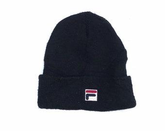 60df4dfb149 Fila small logo embroidery logo fleece snowcap cap snapback