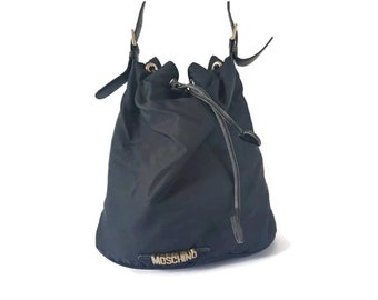 e1ce78732d8 Moschino Redwall vintage 80's logo canvas leather drawstring shoulder  bucket bag, Italian designer bag