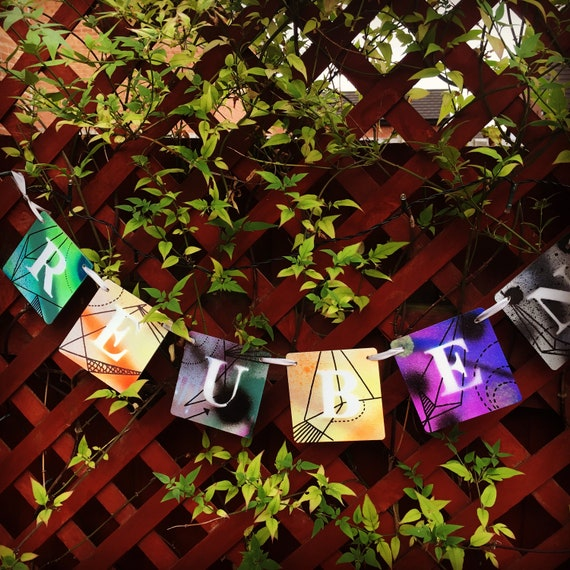 personalised bunting with colourful wooden letter tiles