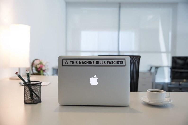 this machine kills fascists sticker mac