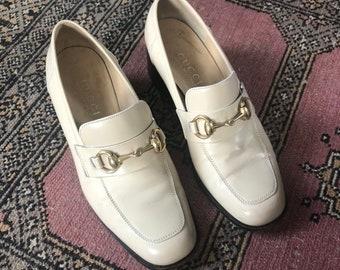 8ead032236a ecru gucci heeled loafers