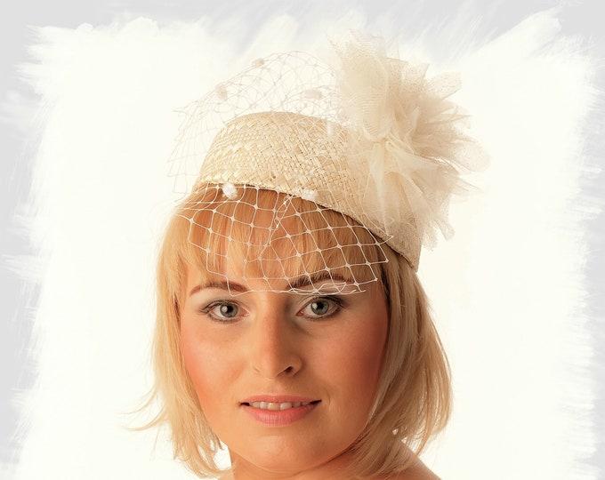 Beige straw pillbox hat