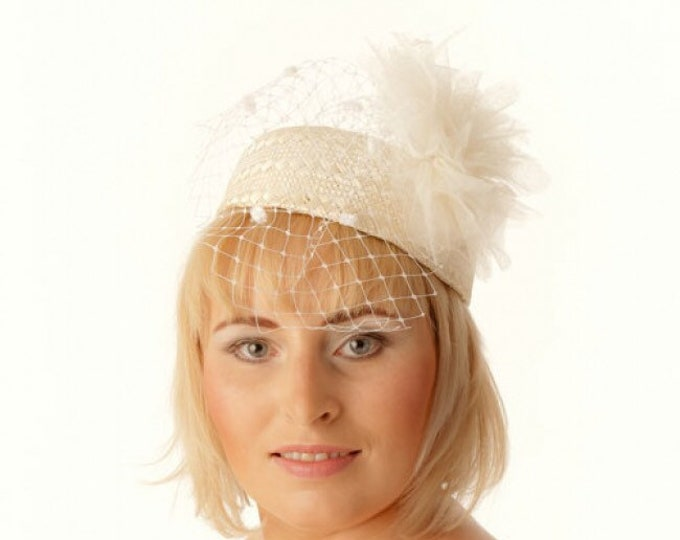 Beige straw pillbox hat