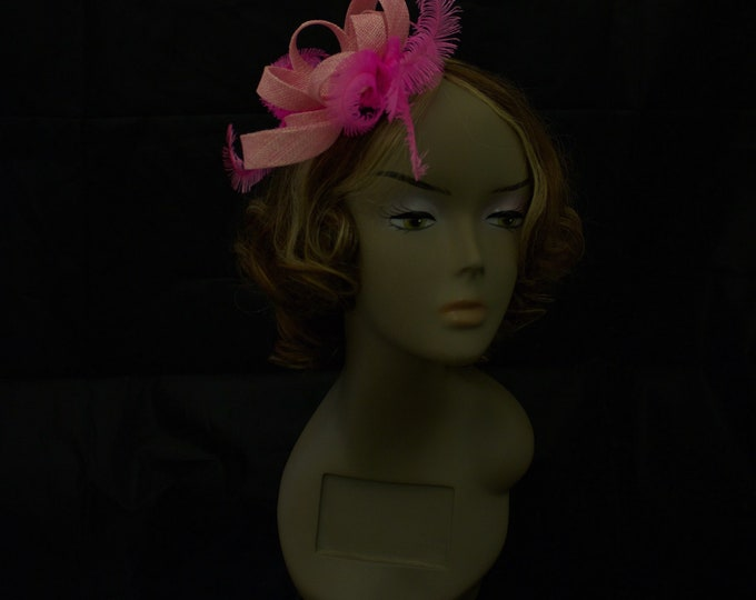Pink sinamay feathers swirl fascinator