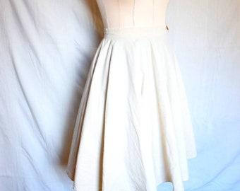 Plate skirt with bag. Knee-length skirt made of organic fabric. Summer skirt for women, waist skirt in beige with button