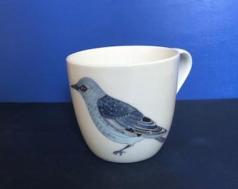 Porcelain mug with printed bird motifs