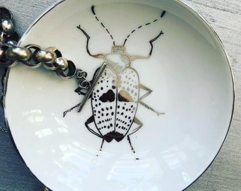 Porcelain bowls with various beetles, hand drawn with platinum