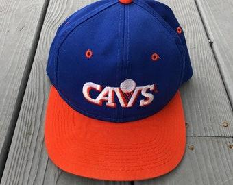 57cc54a1 Vintage 90s Cleveland Cavaliers NBA snapback hat--Blue and Orange