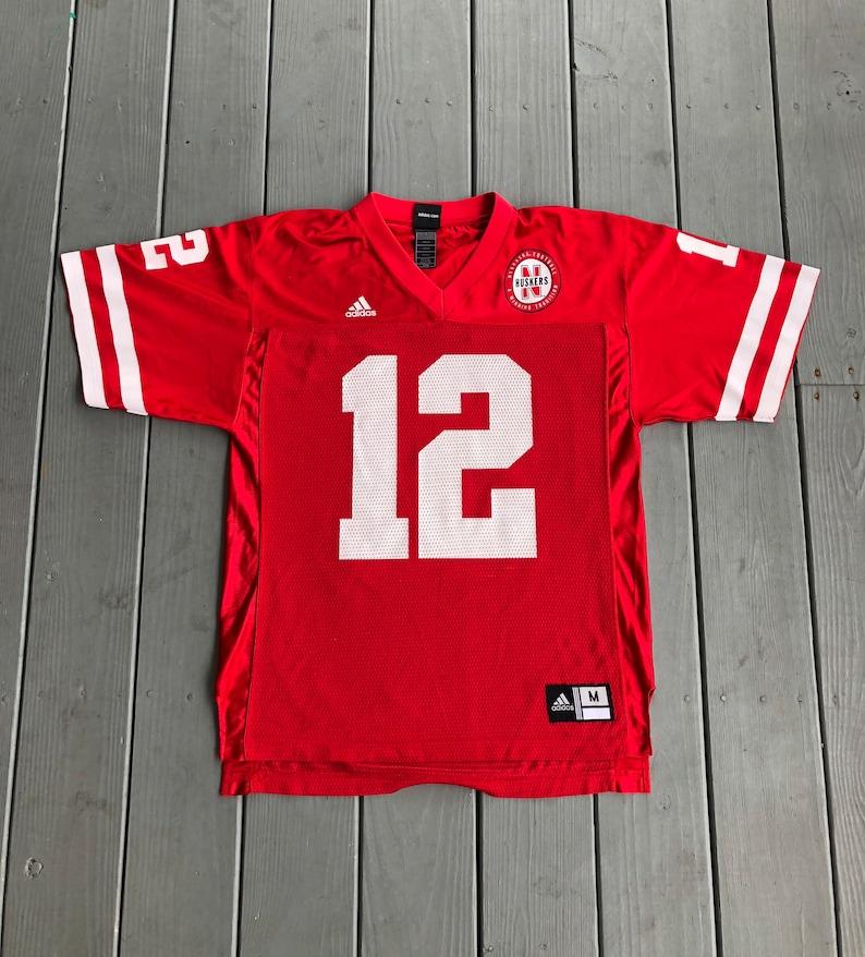 official photos 06fdc f9c69 Adidas University of Nebraska Cornhuskers #12 football jersey-red-size  Medium