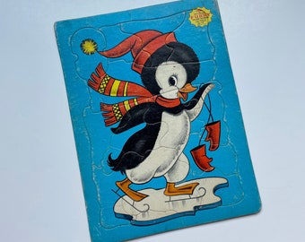 Two vintage children's tray cardboard puzzles Built-Rite Furry Sta-n-Place teddy bear, penguin