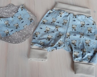 Pump pants + neckerchief for the baby. Bears on unicycle. Light blue-grey