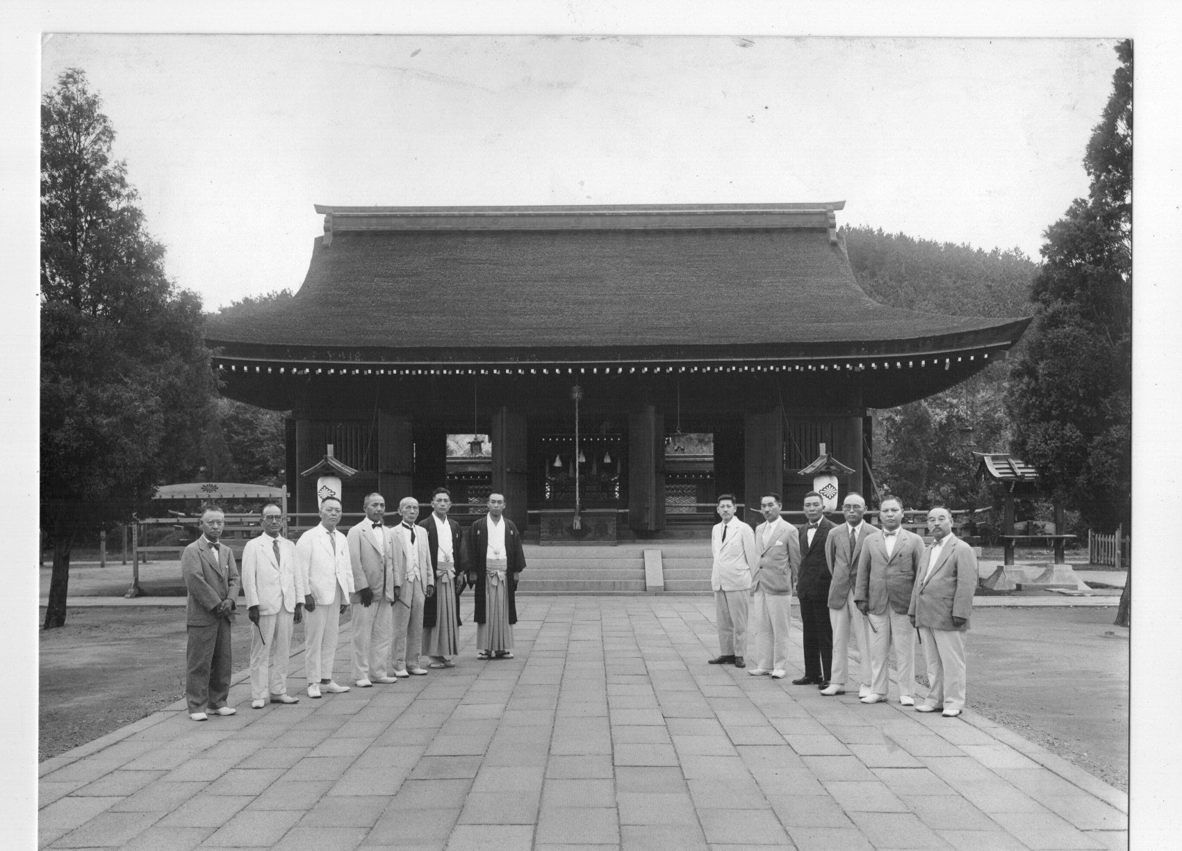 Vintage old black and white photo of a group of japanese men standing in front of a building 8 x 10 1 2