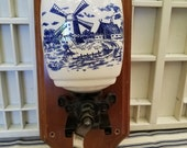 Beautifully decorated blue and white ceramic based coffee grinder. This Dutch look wall mounted coffee grinder has great Farmhouse appeal