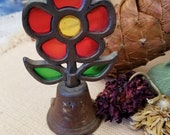 Set of Rusty cast iron stained glass look flower bell and butterfly window hanging. Coupling the rusty iron and the brilliant colors- yum