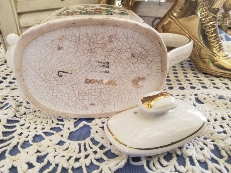 Elegant antique gold embellished teapot from Donegal This Arthur Wood antique English china teapot features beautiful floral designs.