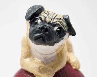 Pug on sea urchins in GIPS, painted and painted.