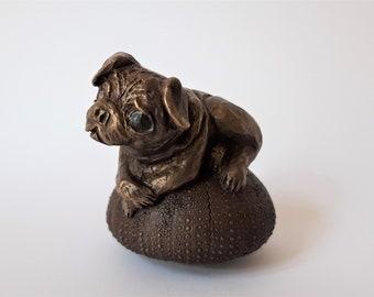 Pug on sea urth, bronze sculpture patinated