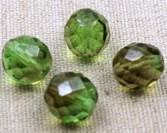 Rondell 10x8mm smaragd Glasschliffperle 10 Stück