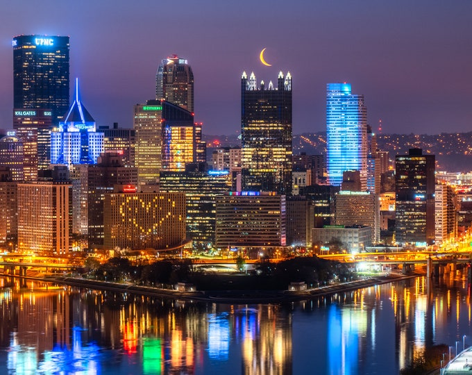 Photo of the Pittsburgh Skyline with Crescent Moon over PPG Place