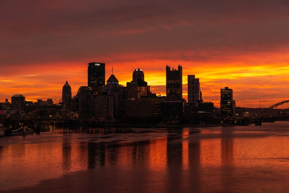 Pittsburgh Skyline Photo with Downtown Silhouetted Against a Vibrant Sunrise