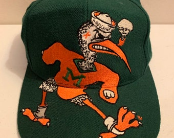 8abc2ab861 Vintage 1980s NCAA University of Miami Hurricanes Sebastian the Ibis  Snapback BIG SPELLOUT Hat