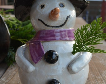 Snowman with purple scarf of clay