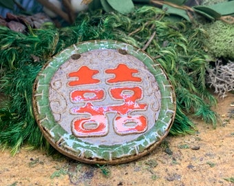 Asian clay type pendant red and green