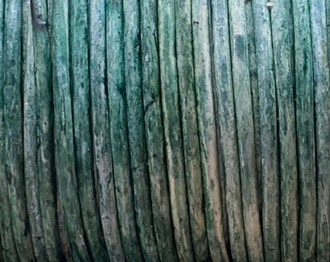 Featured listing image: 1.5mm WEATHERED GREEN BASIL Round Indian Leather -Sold by yard