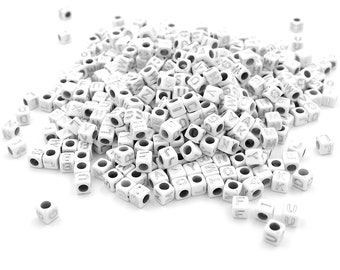 1.2 EUR/100 pcs. Acrylic beads with silver letters as cubes in white 500 pieces