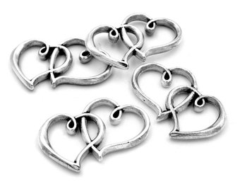 0.5 EUR/1 pcs. Connect as a double heart in antique silver 4 pieces