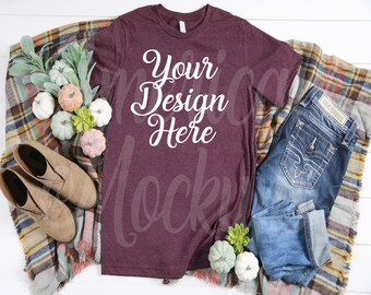 Download Free Bella Heather Maroon 3001 short sleeve crew neck t shirt on wood background mockup flatlay scene photography. PSD Template