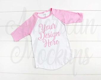 Toddler Pink And White Raglan Shirt Baseball Tee Mockup