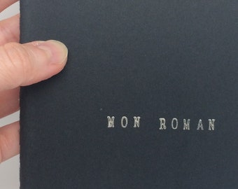 """Carnet de notes A6 avec couverture noire - Cadeau pour auteurs et passionnés d'écriture - """"Mon roman"""""""