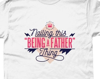f65f69b9 Nailing This Being A Fathers Thing New Dad First Fathers Day Gift - T-Shirt  - Various Colours