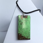 Pendant necklace, oblong green and brown slab on black adjustable necklace cord