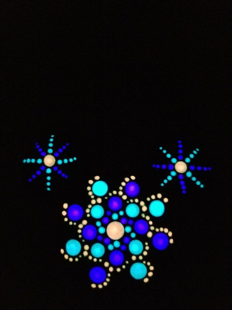 Blue Pink Purple Glow in the Dark Mickey shaped Mandala painted rock Magnet.