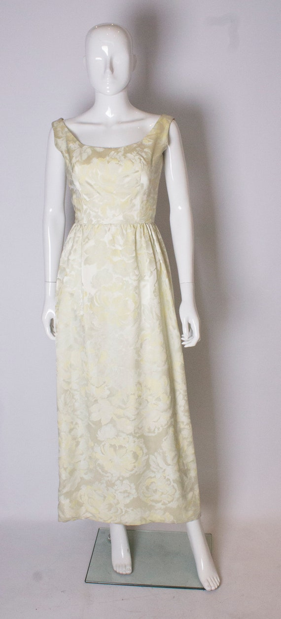 A vintage 1960s yellow floral brocade dress by Sar