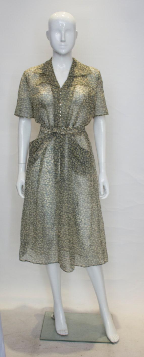 A Vintage 1940s Apple Print day Dress