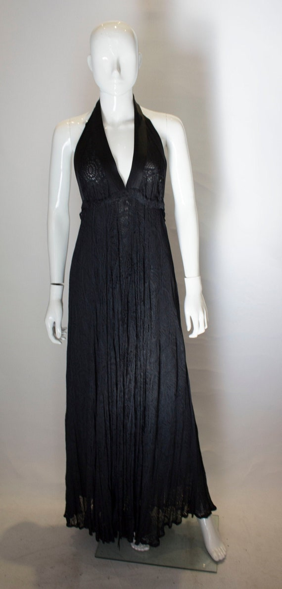 A Vintage 1970s Quorum Black Lace Halter Neck Dres